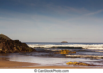Waves on the beach at Polzeath in Cornwall