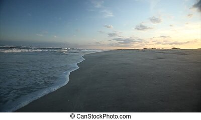 Waves on the beach at sunset
