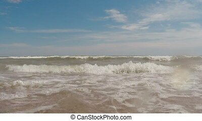 Waves on the beach. Camera underwater