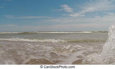 Waves on the beach. Camera underwater