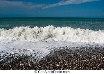Waves on the pebble beach of the Black Sea