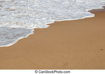 waves on the sand in a desert  beach