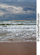 Waves on the sea in cloudy weather
