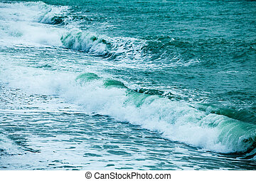 waves on the surface of the blue sea