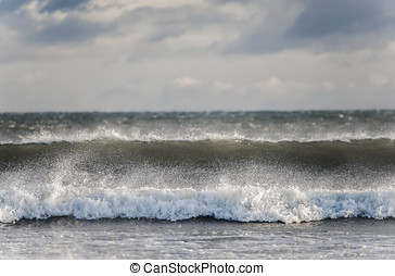 Waves rolling forward onto the beach
