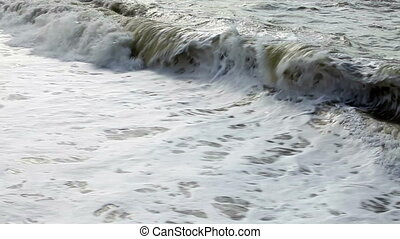 Waves rolling on the beach