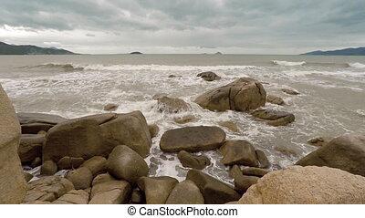 Waves splash over the Hon Chong Rocks near Nha Trang, Vietnam