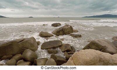 Waves and sea fom wash over the boulders of Hon Chong Rocks, a popular attraction at Nha Trang, Vietnam. UltraHD video