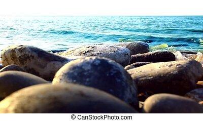 Waves splashes on stone pebble beach - Waves splashes on...