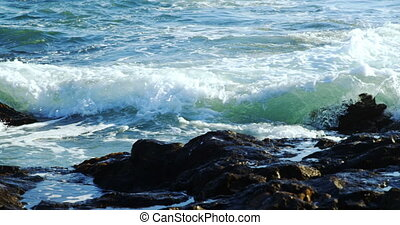 Waves splashing over the rock ion the sea 4k - Waves...