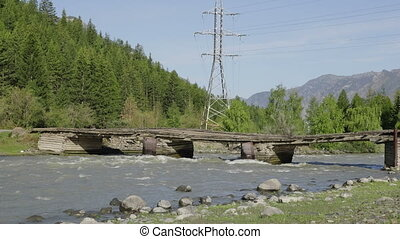 Waves, spray and foam, bridge over the river Katun in Altai mountains. Siberia, Russia