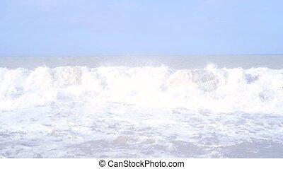 Waves storm on the promenade in Marina di Pisa