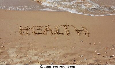 Waves wash the written word health - Waves wash away the...
