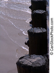 Waves Washing Away from Pilings