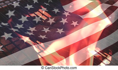 Waving american flag and a grill
