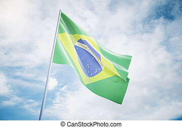 Waving Brazilian flag on a sky background