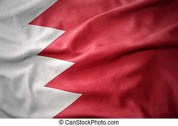 waving colorful flag of bahrain.