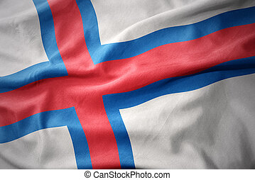 waving colorful flag of faroe islands.