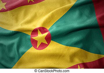 waving colorful flag of grenada.