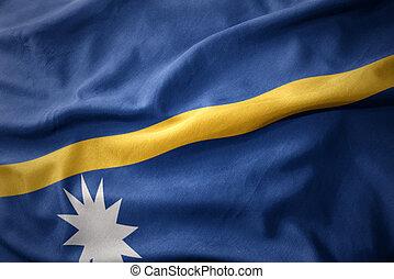 waving colorful flag of Nauru.
