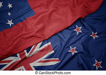waving colorful flag of new zealand and national flag of Samoa.