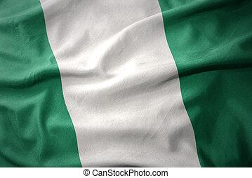 waving colorful flag of nigeria.