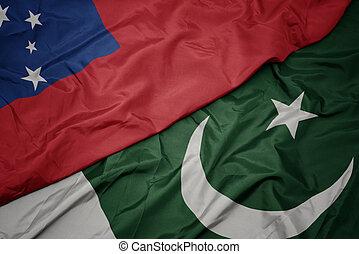 waving colorful flag of pakistan and national flag of Samoa.