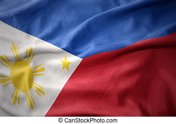 waving colorful flag of philippines.