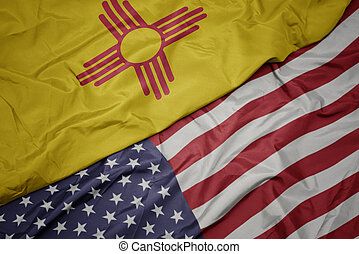 waving colorful flag of united states of america and flag of new mexico state. macro