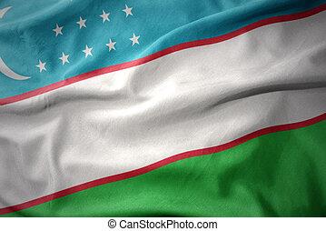 waving colorful flag of uzbekistan.