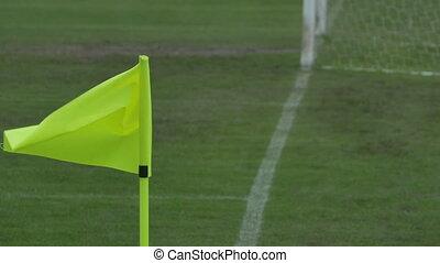 Waving Corner Flag on Pitch - The yellow corner flag waving...
