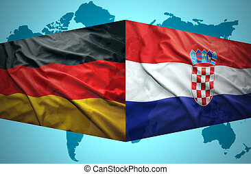 Waving Croatian and German flags of the political map of the world