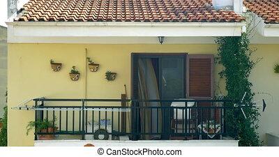 Waving curtain on balcony. Sunny weather