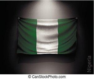 waving flag nigeria on a dark wall