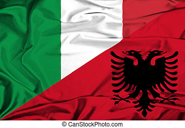 Waving flag of Albania and Italy