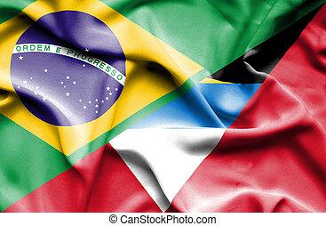 Waving flag of Antigua and Barbuda and Brazil