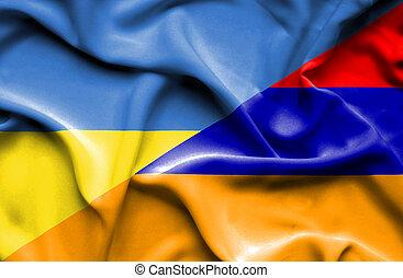 Waving flag of Armenia and Ukraine
