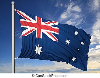 Waving flag of Australia on flagpole, on blue sky background.