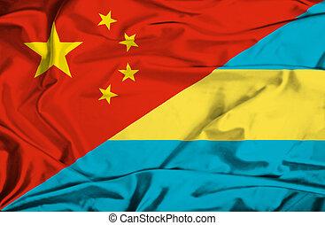 Waving flag of Bahamas and China