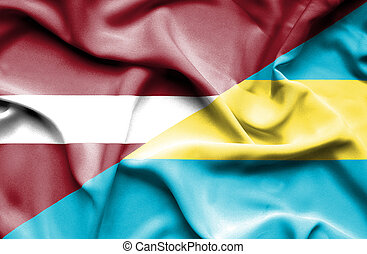 Waving flag of Bahamas and Latvia
