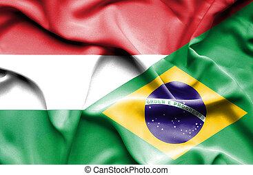 Waving flag of Brazil and Hungary