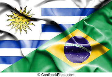 Waving flag of Brazil and Uruguay
