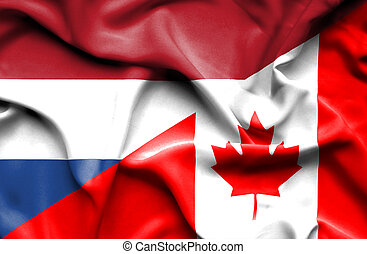 Waving flag of Canada and Netherlands