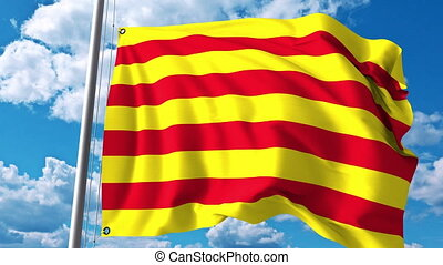 Waving flag of Catalonia against clouds and sky