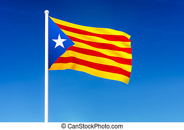 Waving flag of Catalonia on the blue sky background