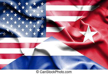 Waving flag of Cuba and USA