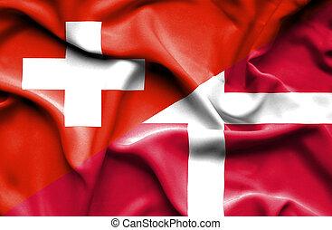 Waving flag of Denmark and Switzerland