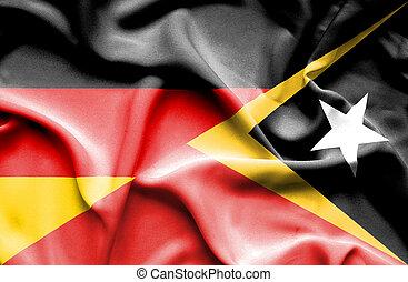 Waving flag of East Timor and Germany