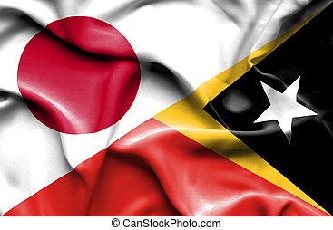 Waving flag of East Timor and Japan