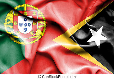 Waving flag of East Timor and Portugal